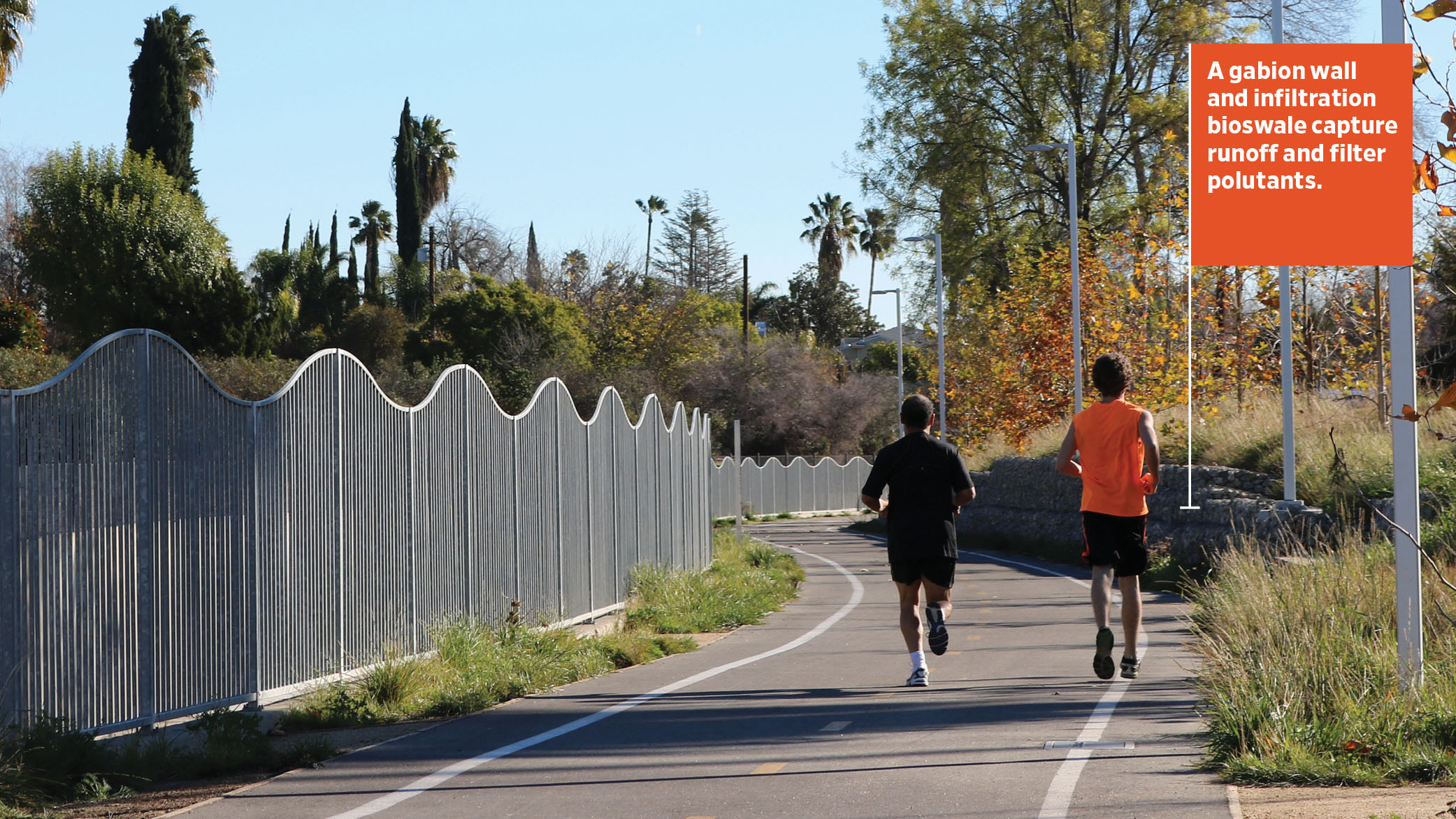 As runners jog by on the LA Riverfront Greenway, a gabion retaining wall and infiltration bioswale capture runoff and filter pollutants.